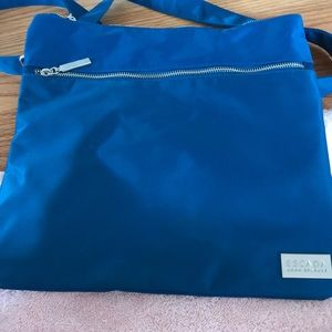 Thin, light blue shoulder bag from Escada. New!